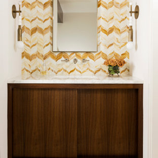 Inspiration for a medium sized midcentury cloakroom in Houston with white walls, flat-panel cabinets, dark wood cabinets, multi-coloured tiles, a submerged sink, beige floors, white worktops and a freestanding vanity unit.