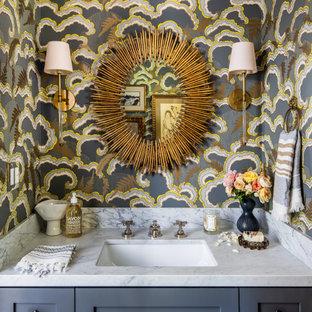 サンフランシスコの中くらいのトランジショナルスタイルのおしゃれなトイレ・洗面所 (シェーカースタイル扉のキャビネット、グレーのキャビネット、マルチカラーの壁、アンダーカウンター洗面器、グレーの洗面カウンター、造り付け洗面台、壁紙) の写真