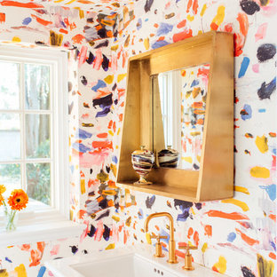 Photo of an eclectic powder room in Other with multi-coloured walls and a pedestal sink.