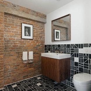 Ispirazione per un bagno di servizio design con ante lisce, ante in legno bruno, WC sospeso, pistrelle in bianco e nero, pareti bianche, lavabo sospeso, pavimento nero, top bianco e pavimento in cementine