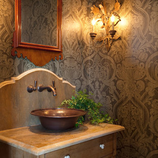 Powder room - farmhouse powder room idea in Nashville with a vessel sink, medium tone wood cabinets and brown countertops