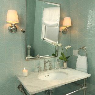 На фото: туалет среднего размера в современном стиле с синей плиткой, керамической плиткой, мраморным полом, монолитной раковиной, мраморной столешницей и серым полом с