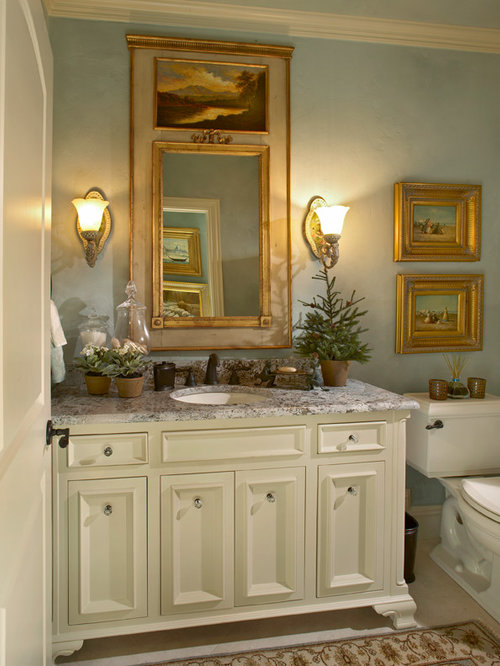 inspiration for a mid sized timeless beige tile powder room remodel in dallas with an