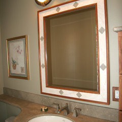 mediterranean powder room by Grayling Construction