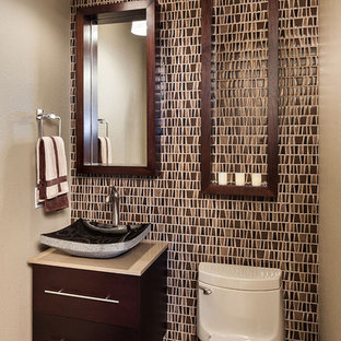 Photo of a traditional powder room in Portland with mosaic tile and a vessel sink.