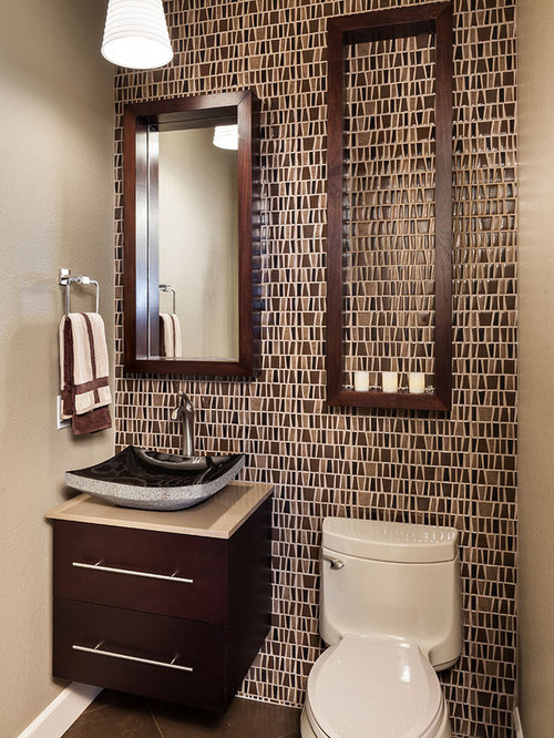 Example of a classic powder room design with mosaic tile and a vessel