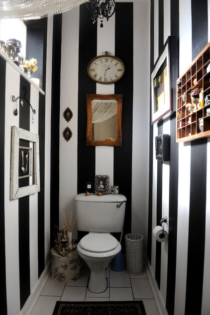 Black & White striped wallpaper, guest bathroom with white fixtures