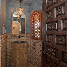 Mediterranean Powder Room by Hamilton-Gray Design, Inc.