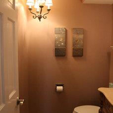 Traditional Powder Room half-bath with chandelier