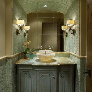 На фото: туалет в современном стиле с мраморной столешницей, настольной раковиной, синими фасадами и зеленой столешницей с
