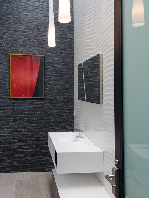 Trendy White Tile And Black Tile Powder Room Photo In Los Angeles With A  Wall