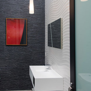 Trendy white tile and black tile powder room photo in Los Angeles with a wall-mount sink