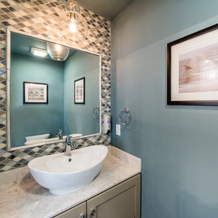 This is an example of a small traditional cloakroom in Other with shaker cabinets, beige cabinets, a two-piece toilet, multi-coloured tiles, mosaic tiles, grey walls, dark hardwood flooring, a pedestal sink, engineered stone worktops and brown floors.