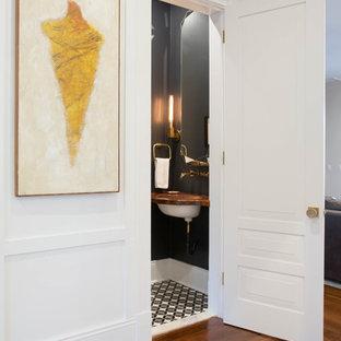 Immagine di un piccolo bagno di servizio classico con pistrelle in bianco e nero, piastrelle di cemento, pareti grigie, pavimento in cementine, lavabo sottopiano e top in legno