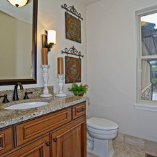 Traditional Powder Room by Celebrity Communities