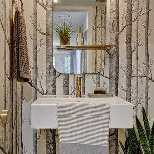 Inspiration för ett litet funkis toalett, med ljust trägolv, ett väggmonterat handfat, flerfärgade väggar, bänkskiva i akrylsten och beiget golv