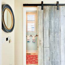 Beach Style Powder Room by Echelon Custom Homes