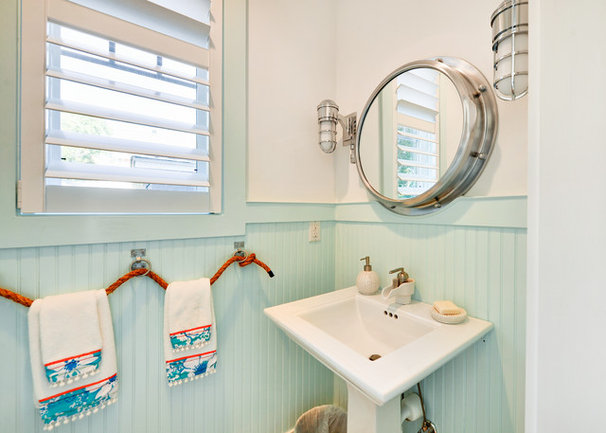 Beach Style Powder Room by Echelon Custom Homes