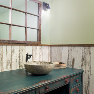 This is an example of a medium sized rustic cloakroom in Jackson with freestanding cabinets, distressed cabinets, a two-piece toilet, multi-coloured tiles, porcelain tiles, green walls, porcelain flooring, wooden worktops, orange floors, green worktops and a vessel sink.