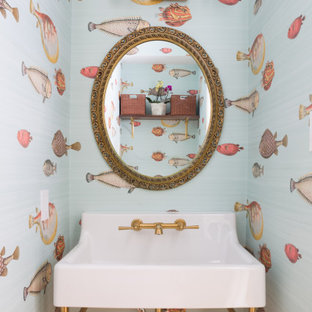 Inspiration for a small transitional powder room remodel in San Francisco with a console sink
