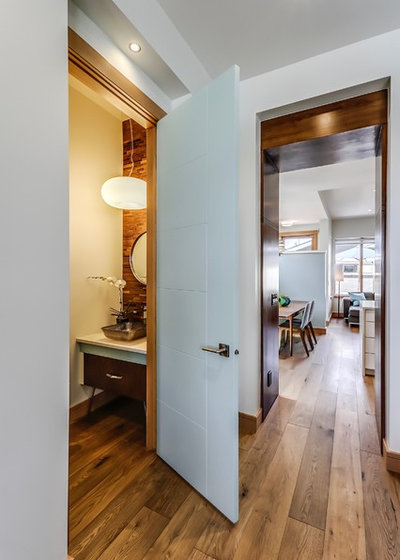 Midcentury Powder Room by Lighthouse Studios Residential Design