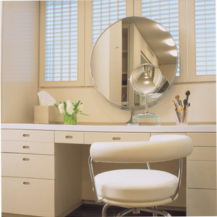 Example of a trendy powder room design in Chicago with flat-panel cabinets and beige cabinets