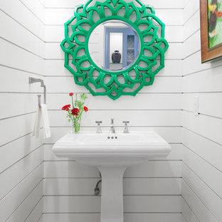 Powder room - beach style powder room idea in Denver with a pedestal sink and white walls