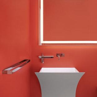 Неиссякаемый источник вдохновения для домашнего уюта: туалет в современном стиле с оранжевыми стенами, подвесной раковиной и серым полом