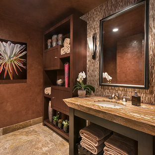 Photo of a large contemporary cloakroom in Other with stone tiles, multi-coloured walls, travertine flooring, a submerged sink, onyx worktops, flat-panel cabinets, dark wood cabinets and multi-coloured tiles.
