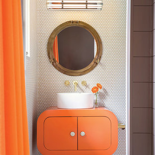 This is an example of a small modern cloakroom in Seattle with flat-panel cabinets, orange cabinets, white tiles, ceramic tiles, white walls, ceramic flooring, a vessel sink, solid surface worktops, white floors and orange worktops.