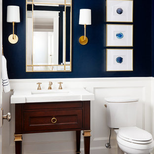 Design ideas for a small classic cloakroom in Chicago with freestanding cabinets, dark wood cabinets, a two-piece toilet, blue walls, a submerged sink, grey floors, porcelain flooring and marble worktops.