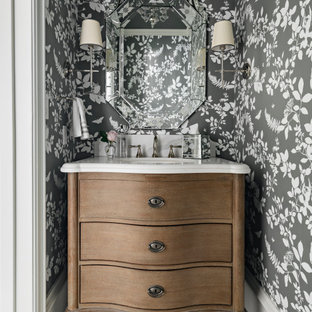 Inspiration for a small traditional powder room in Phoenix with an undermount sink, quartzite benchtops, white benchtops, furniture-like cabinets, medium wood cabinets, multi-coloured walls and multi-coloured floor.