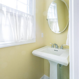 Cloakroom in Richmond with yellow walls, slate flooring, a pedestal sink and grey floors.