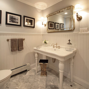Powder room - traditional powder room idea in Other with a console sink