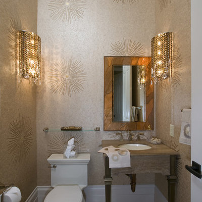 Inspiration for a small contemporary travertine floor and beige floor powder room remodel in Sacramento with an undermount sink, beige walls, a one-piece toilet, furniture-like cabinets, marble countertops and beige countertops