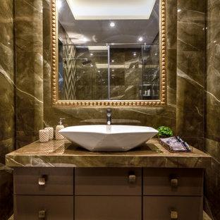ムンバイの中くらいのコンテンポラリースタイルのおしゃれなトイレ・洗面所 (フラットパネル扉のキャビネット、グレーのキャビネット、グレーのタイル、ベッセル式洗面器、グレーの床、グレーの洗面カウンター、造り付け洗面台) の写真
