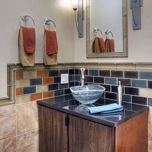На фото: маленький туалет в современном стиле с плоскими фасадами, коричневыми фасадами, бежевой плиткой, синей плиткой, оранжевой плиткой, керамогранитной плиткой, бежевыми стенами, полом из керамогранита, настольной раковиной, столешницей из гранита, бежевым полом и серой столешницей с