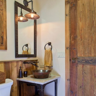This is an example of a medium sized rustic cloakroom in Denver with shaker cabinets, medium wood cabinets, a two-piece toilet, white walls, slate flooring, a vessel sink and marble worktops.