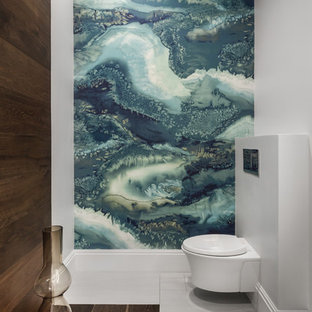 Inspiration for a medium sized contemporary cloakroom in Tampa with a wall mounted toilet, grey walls, porcelain flooring, grey floors, multi-coloured tiles and stone slabs.
