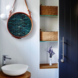 Inspiration for a beach style powder room in Central Coast with white walls and a vessel sink.
