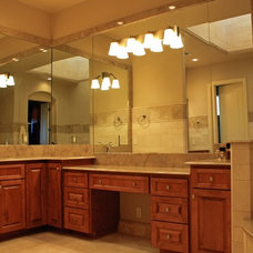 Mediterranean Powder Room by SILVERTON CUSTOM HOMES