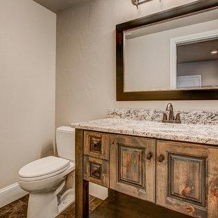 Идея дизайна: туалет среднего размера в стиле современная классика с фасадами с выступающей филенкой, фасадами цвета дерева среднего тона, раздельным унитазом, бежевой плиткой, каменной плиткой, бежевыми стенами, полом из керамогранита, врезной раковиной и столешницей из гранита