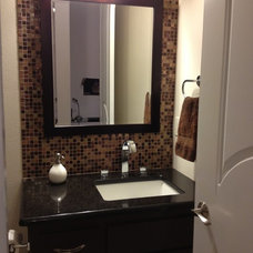Traditional Powder Room by Zero Latitude