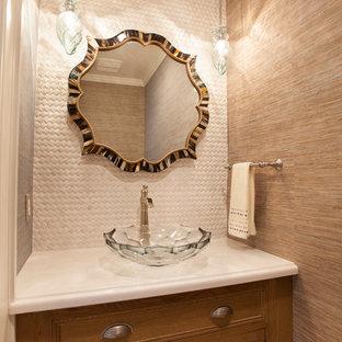 Imagen de aseo exótico, de tamaño medio, con armarios con puertas mallorquinas, puertas de armario de madera oscura, baldosas y/o azulejos blancos, baldosas y/o azulejos en mosaico, lavabo con pedestal, encimera de mármol y paredes marrones