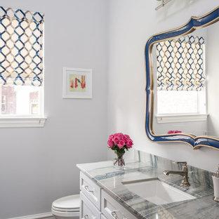 Cette photo montre un WC et toilettes chic de taille moyenne avec un placard avec porte à panneau encastré, des portes de placard blanches, un WC séparé, un mur gris, un sol en bois foncé, un lavabo encastré, un plan de toilette en quartz, un sol marron et un plan de toilette multicolore.