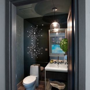 Small minimalist dark wood floor powder room photo in Miami with an undermount sink, a two-piece toilet, black walls, open cabinets and quartz countertops
