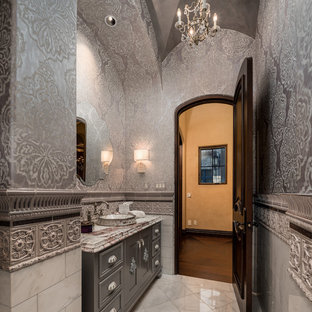 Design ideas for a large modern cloakroom in Phoenix with raised-panel cabinets, grey cabinets, a two-piece toilet, multi-coloured tiles, ceramic tiles, multi-coloured walls, marble flooring, a built-in sink, marble worktops, beige floors and yellow worktops.