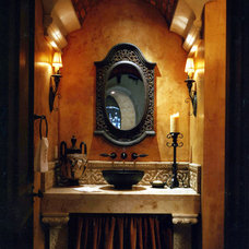 Mediterranean Powder Room by Terry L Irwin Architects