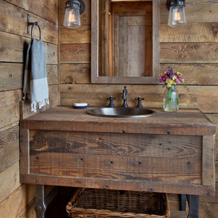 Design ideas for a rustic cloakroom in Other with freestanding cabinets, medium wood cabinets, a built-in sink, wooden worktops and brown worktops.