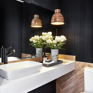 Contemporary powder room in Brisbane with a one-piece toilet, brown tile, black walls, a vessel sink, brown floor and white benchtops.